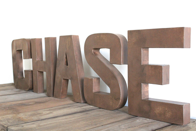 "Woodland theme ""wooden"" nursery letters spelling out CHASE."