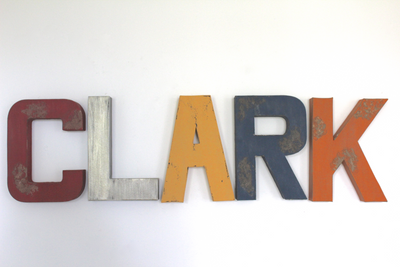Clark nursery name letters in different distressed colors like red, navy, yellow and blues.