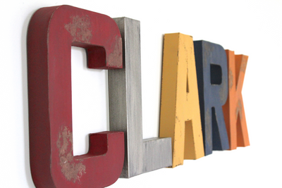 Bear themed nursery name letters spelling out Clark in fun rustic colors like red, silver, yellow, navy, and orange.