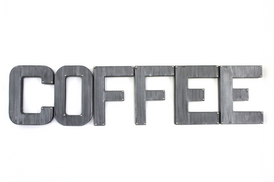 """Metal""coffee wall sign in a silver finish with nail studs on the corners."