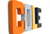 Bright and bold nursery wall letters spelling out the name Cole in orange, black, silver, and yellow.