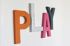 Kids playroom play wall sign for kid's nursery and playroom wall decor in orange, pink, silver, and navy.