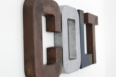 Custom wall letters for kids bedroom decor in brown, silver, and grey.