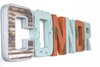 Connor nursery letters in silver, brown, orange, and blue.