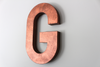 Large copper letter G for photo prop