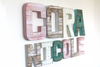 Wall name signs for girl's room decor spelling out the name Cora Nicole.