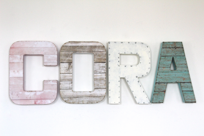 "Cora name sign for girl's room decor in white, pink, and teal ""wooden"" letters."