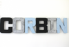 Boy name wall letters in modern colors like black, silver, and blue spelling out the name Corbin.