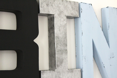 Custom wall letters in black, silver, and blue.
