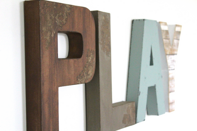Rustic playroom PLAY sign in soft rustic colors.