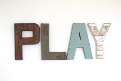 Play sign in brown, grey, blue, and white for boy playroom decor.