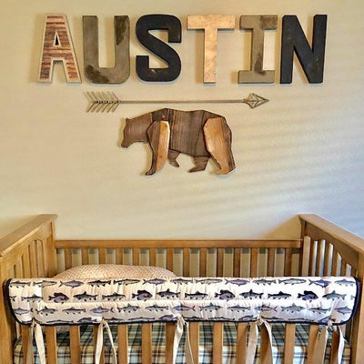 Bear themed nursery wall letters spelling out the name Austin for a boys nursery.