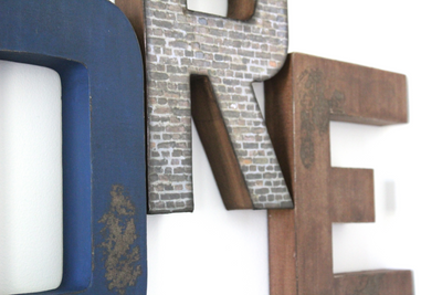 Rustic and distressed letters in navy blue and browns.
