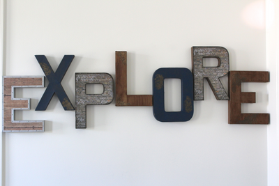 Industrial farmhouse explore sign for playroom wall decor.