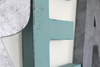 Silver, blue, and brown letters spelling out the word dream for playroom wall decor.