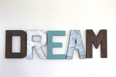 "Dream wall letters in brown ""wooden"" letters, silver, and blue."
