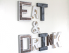 "Eat and Drink Wall sign in ""metal"" and ""wooden"" letters."
