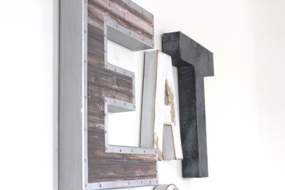 Rustic kitchen wall letters spelling out the word EAT.
