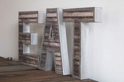 "Freestanding ""metal"" and ""wooden"" EAT letters with nail trim design"