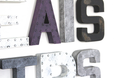 "Rustic ""wooden"" and ""metal"" letters in different colors like white, purple, gray, silver, and black."