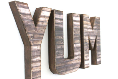 Rustic farmhouse YUM sign for kitchen wall decor.
