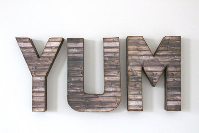 YUM wall letters in a rustic farmhouse style for a classic farmhouse styled kitchen.