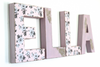 Farmhouse chic wall letters in pink spelling out ELLA.