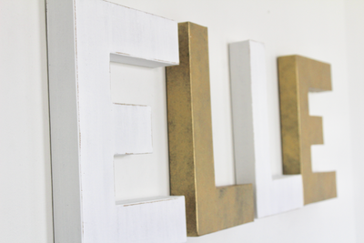 White and Gold wall letters spelling out the name ELLE for a girls modern nursery wall decor.