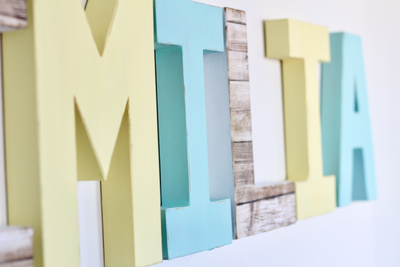 Pastel yellow and aqua girl nursery letters for girls room decor.