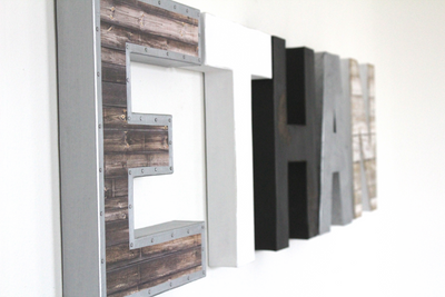 Modern farmhouse nursery custom wall letters spelling out Ethan in different modern colors and farmhouse textures.