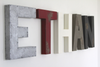 Ethan custom wall letters in silver, red, white, grey, and black.