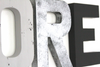 "Silver ""metal"" letter R, gray letter O, and a black letter E spelling out the word Explore for playroom wall decor."
