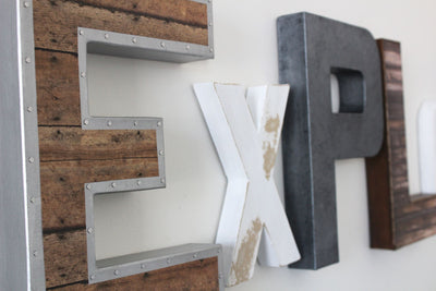 "Explore wall sign for boys playroom wall decor in white and gray ""wooden"" and ""metal"" letters."