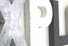 Silver, white, and gray monochrome letters for playroom wall decor.