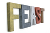 "FEAST ""metal"" wall letters in different colors like brass, copper, gray, silver, and bronze."
