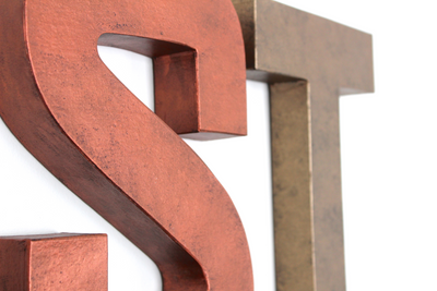 "Copper ""metal"" wall letter S and bronze letter T."