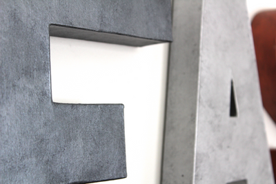 "Gray and silver ""metal"" wall letters."