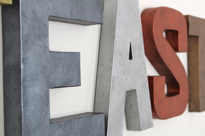 "Gray and silver ""metal wall letters."
