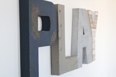 Playroom letters in navy, grey, silver, and white for boys playroom decor.