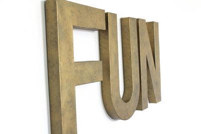 Fun playroom wall letters in a faux brass industrial style.