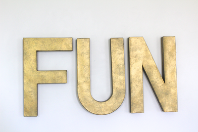 Fun wall sign in brass colors for industrial playrooms.