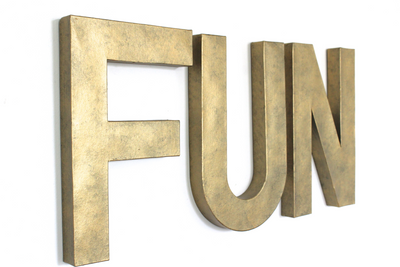 Industrial FUN playroom wall letters in a faux brass style.