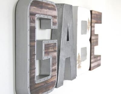 Boy name wall letters spelling out the name GABE in an industrial farmhouse finish.