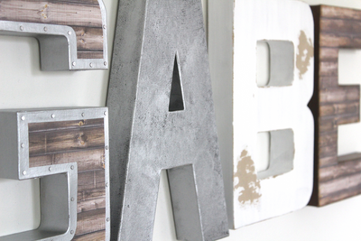 Silver, Brown, and White wall name letters in a rustic farmhouse and industrial finish.