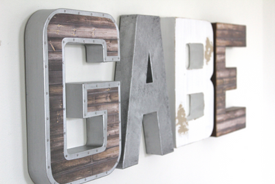 Boy nursery name letters spelling out the name GABE in brown, white, and silver letters.