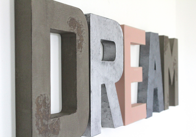 Dream wall playroom letters in silver and pink letters.