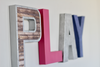 Girls playroom sign in pink and purple.