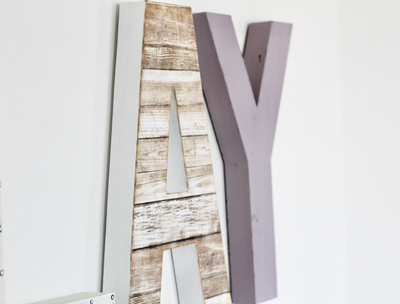 Pastel purple letter Y and a faux wooden reclaimed letter A.