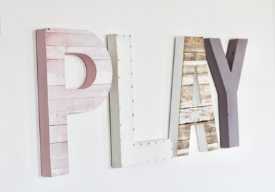 Girls playroom sign in soft pinks, white, and purples.