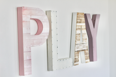 Girls playroom sign in pinks and purples.